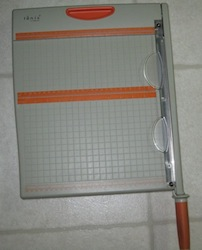 Guillotine trimmer used in scrapbook and card making