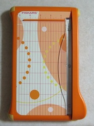Small guillotine trimmer used in scrapbook and card making